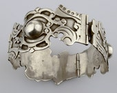 Rare vintage Taxco hinged silver bracelet by Spratling. Hand-made and very special.