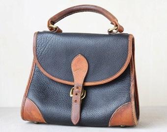 Vintage Black and Brown Dooney and Bourke purse // Leather Purse // Dooney handbag// duck purse //