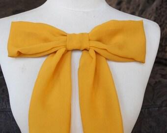 Cute yellow   color chiffon bow applique