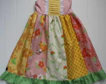 ON SALE SpringTime Stripwork Dress available in sizes 2T through 12 girls.