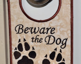 Beware the Dog Door Hanger