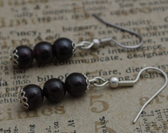 Three garnet beads earrings