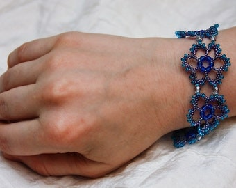 Beadwork Lace Flower Bracelet in Iris Violet, Turquoise, and Misty Grey.