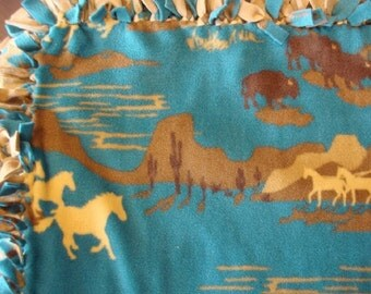 Western Tied Fleece Blanket with torquoise background