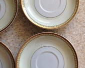 6 available  White and Gold and yellow Limoges saucers