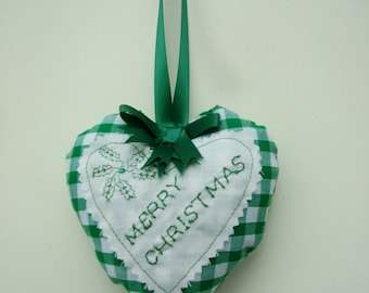 Christmas decoration. Handmade heart with Merry Christmas message.
