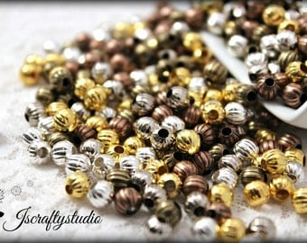 50 Assorted Metals 6mm Pumpkin Shaped Lantern style spacer beads