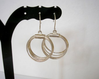 Silver tone metal hoop hook earrings