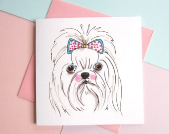Maltese With patterned Bow In Hair. Maltese. Maltese Dog Lover. Blank. 5.5 Inch. Square. Greetings Card