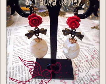 """Antique Brass Bow, Red Resin Roses and Mother of Pearl Earrings. """"Rosa Pearl"""" Design by Laura Gomez"""