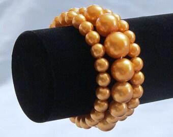Pearl Bracelet...Peach Faux Pearls on Multi Strand Wire