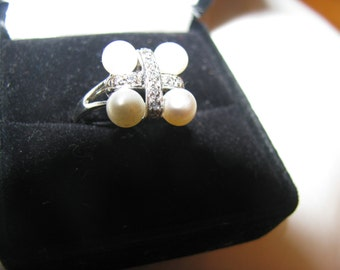 1960s adjustable pearl ring. Real jewelry look but no silver or gold content - think pearls are real.