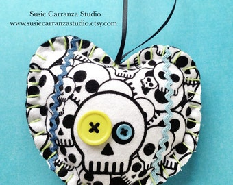 Hand Stitched Skull Fabric Heart Ornament. Chartreuse and blue buttons. Blue rick rack ribbon. Lime green embroidery floss stitching.