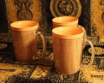 cantaloup colored coffee mugs plastic rattan Mid-century