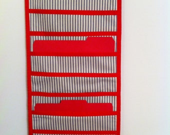 Adorable blue and white small stripe hanging file holder trimmed in bright red!