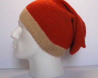 Unisex hand knitted super slouchy beanie hat. Adult or teenager. Beige and burnt orange.