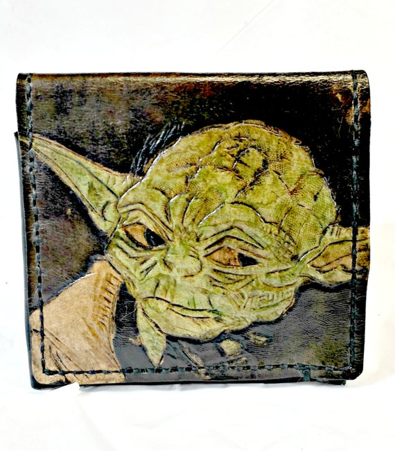 Yoda! This Star Wars Wallet will make a great Star Wars Gift for any Yoda Fan. Holds 12 cards, 2 slots