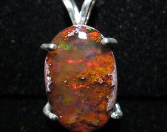 Opal in matrix in silver bezel 7ct