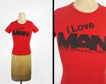 Vintage 70s Men's Apparel News T-shirt Red Graphic Tee Made in USA - Women's Small