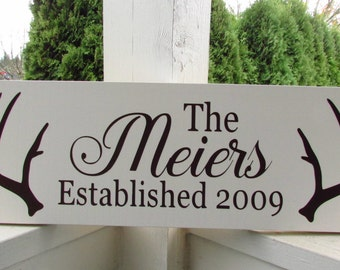 Personalized sign with name, established date and antlers - custom family wood sign in colors of your choice