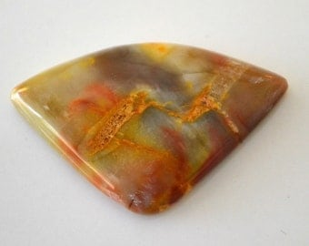 Ohio flint cabochon.  pastels with bright yellow. 23 x 36.6 x 5.5