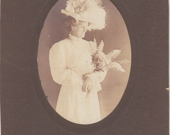 Vintage/ Antique beautiful cabinet  Photo of a woman in a dress and fabulous hat holding a bouquet