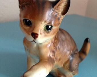 Ceramic brown kitten with raised paw