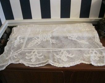 Sixty inch square net darning tablecloth