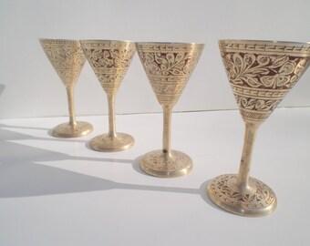A 4 piece set of vintage Brass Goblets
