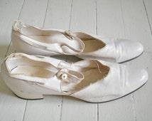Antique white wedding shoes
