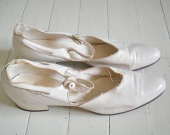 Antique white wedding shoes
