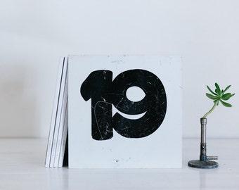 vintage metal number sign - nineteen