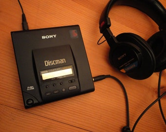 SALE ! Metal Sony Discman D303 Vintage Optical Digital Portable CD Player D-303 + Rechargeable Battery & Power Adapter as is nice condition!