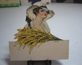 Gorgeous 1910's-20's unused die cut Chas. S. Clark place card pretty edwardian era lady wearing large hat holding wheat artist signed M.H.S.