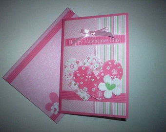 Handmade Valentine card with hearts and matching envelope.