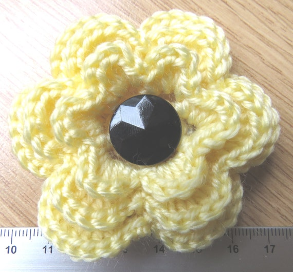 New 1940s Costume Jewelry: Necklaces, Earrings, Pins Irish crochet flower brooch in yellow wool with black glass button centre $5.32 AT vintagedancer.com