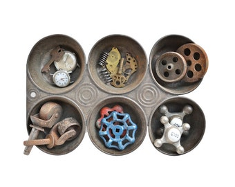 vintage muffin tin, baking pan, STUFFED, steampunk supplies, industrial organizer, faucet knobs, casters, watch parts
