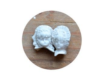 2 damaged antique german bisque girl doll heads sisters, doll fragments, bonnets, from Elizabeth Rosen