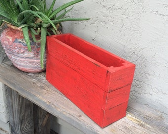 Shabby red book crate