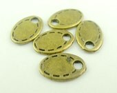 16 Tiny Tag Charms Antique Bronze 10 x 7 mm  Ships From The United States - bz311