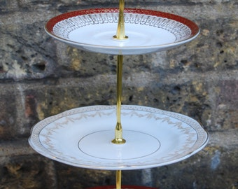 Vintage cake stand with elegant gold and burgundy china