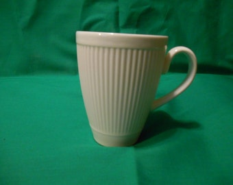 """One (1), 3 7/8"""" Mug, from Wedgwood, in the Windsor Pattern."""