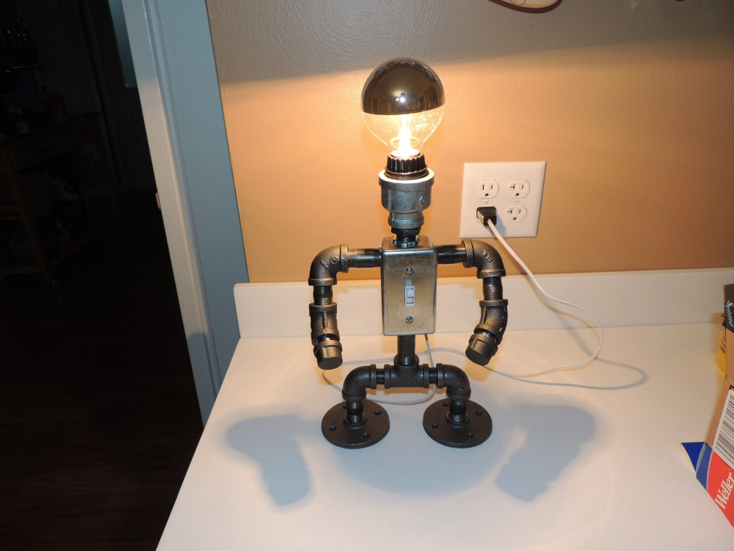 Black pipe table lamp robot with light switch