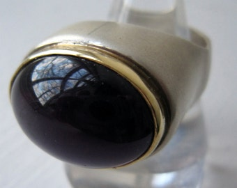 Designer made silver ring with gold bezel