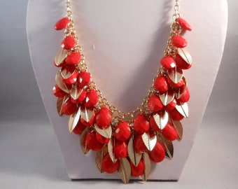 Bib Necklace with Red/Orange Teardrop Beads and Gold Leaf Beads Pendant on a Gold Tone Chain Mesh and Chain