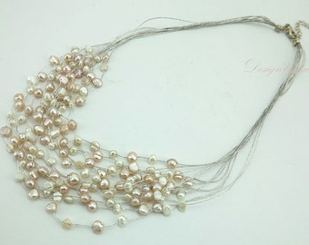 Light pink freshwater pearl multi strand necklace.