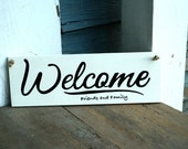welcome friends and family, wood sign