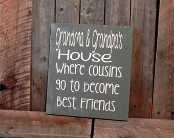 Grandma and Grandpa's.. where cousins become friends.. solid wood sign