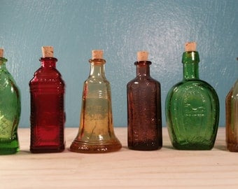 Six Miniature Colorful Bottles