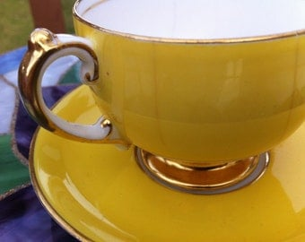 Tea cup and saucer canary yellow made in england Grosvenor china